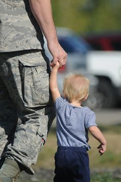 Master Sgt. Donavon Jorissen, of the North Dakota #NationalGuard 's 119th Maintenance Squadron, walks hand-in-hand with his daughter at Family Day events at the North Dakota Air National Guard.