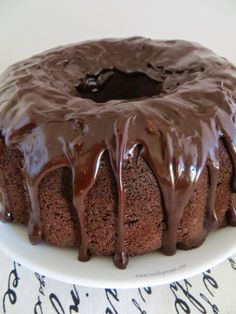 Chocolate cake and fudgy brownie batter are combined, then topped off with a creamy ganache. This outrageous bundt cake is a chocoholic nirvana.