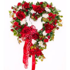 This red rose heart wreath is perfect for Valentine's day, anniversary, or used as an everyday wreath. With red roses in bloom, red rose buds, white hydrangea, this is a classic wreath all set on an a