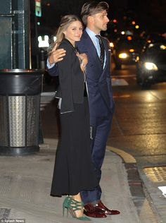Smitten pair: The couple had spent the evening mingling with the great and good of the fashion world at the Giorgio Armani One Night Only pa...