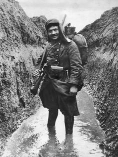 French soldier in a watery trench.