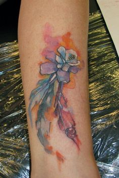 Colorado state flower, Columbine, with feathers tattoo