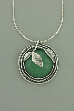 Aventurine Puff Necklace    Hand made, sterling silver chain, round Aventurine stone with sterling silver leaf in front.    Chain: 16 in. long; Pendent: 1 in. radius.  Price: $128.00 $89.60