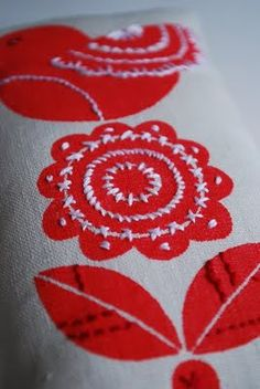 I like this idea - screen print and embroidery
