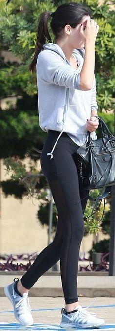 Who made  Kendall Jenner's gray sneakers, black leather handbag, and mesh black leggings?