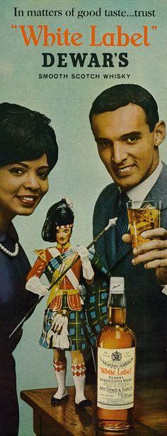 "https://flic.kr/p/hmP3D1   1963 Liquor Ad, ""White Label"" Dewar's Blended Scotch Whisky   Vintage 1960s magazine advertisement, ""White Label"" Dewar's Blended Scotch Whisky, 1963 Tagline: ""In matters of good taste... trust 'White Label' Dewar's Smooth Scotch Whisky"" Published in Ebony, October 1963 - Vol 18, No. 12"