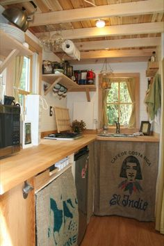 I'll probably do something like this for kitchen cabinets (curtains under countertop)... not sure of what I want to do for storage above the countertop yet