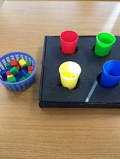 Sorting Target color blocks into Dollar Tree color cups held in a pizza box.  You could simply used color bowls that you already have too.