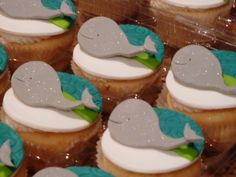 Whale cupcakes for a baby shower - Matched client's invitation for these lemon cupcakes with fondant design.  Next time I'll be a little neater with the buttercream underneath!