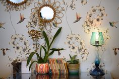 Harlequin's Amazilia wallpaper featuring painterly hummingbirds on display in our Chelsea Harbour showroom.