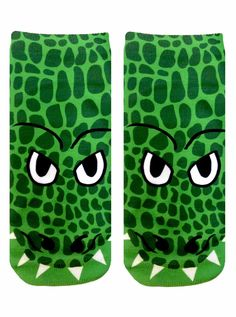 """Get your hands on these fun crocodile ankle socks! *UNISEX *100% POLYESTER *MADE IN THE USA *ONE SIZE FITS MOST * 7.5"""" L X 3"""" W PRINTED ON ONE SIDE ONLY."""