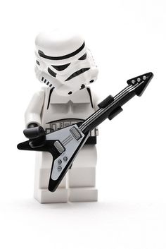 Reminds me of my brothers...Noel, Chip, Seth and Kenneth :) a lil star wars and guitar hero!