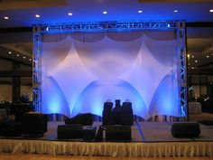 Stage Lighting & Backdrop from Ideal Party Decorators - www.idealpartydecorators.com