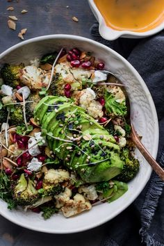 is the perfect mid winter nourish bowl. Roasted broccoli and cauliflower drizzled with a lemon garlic dressing and topped with all the winter essentials. Pomegranate, toasted almonds and goat's cheese. Swap goat cheese for vegan alternative for a vegan dish.