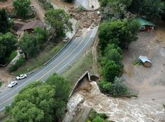 The Big Thompson River floods a roadway and homes near the Big Thompson Canyon Friday September 13, 2013.