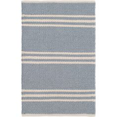 Were doing a design double-take over this easy-care, eco-friendly rug in a pretty pale blue stripe. This durable indoor/outdoor area rug is a natural fit for any decor style, from country chic to urban cool.Made of 100% PET, a polyester fiber made from recycled plastic bottles.In order to achieve its rustic charm, this rug has been woven with large-diameter yarns. Consequently, slubs, knots, and other imperfections inherent to the hand-weaving process may be more visible on this style of...