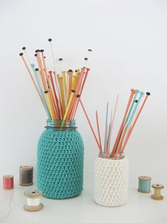 Store your knitting or crochet needles in a jar adorned with your own knit-work...