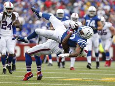 Buffalo Bills strong safety Bacarri Rambo tackles Indianapolis Colts wide receiver Donte Moncrief, top, after a catch during the first half in Orchard Park, N.Y. The Bills won 27-14.  Kevin Hoffman, USA TODAY Sports