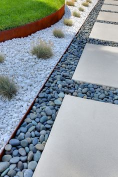 I really like the idea of large concrete stones set inside these smaller riverrock pebbles - thinking this Idea could also be used in a traditional landscaping ...Permeable hardscaping concrete retains moisture and helps reduce the need for watering.