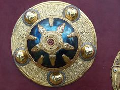 Sutton Hoo shield boss Anglo Saxon ~ Note: The center represents the sun and the raven rays could represent the Celtic god associated with the raven, a giant of enormous strength. (www.avesnoir.com)