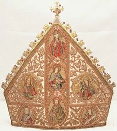 The Bute mitre, gifted by wealthy Roman Catholic convert John Patrick Crichton Stuart, the Marquess of Bute, in recognition of the Roman Catholic hierarchy being set up anew in Scotland, and the Archdiocese of St Andrews and Edinburgh being named the country's metropolitan see. The richly embroidered episcopal mitre, which on occasions is still worn by the Archbishop of St Andrews and Edinburgh, depicts Christ and the Virgin Mary along with a number of saints, including St Andrew.