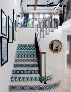Going for a more traditional look? Don't be afraid to add a splash of pattern or color on the risers, like this beach style home did with fun Mediterranean tiles. At the end of the day, just be sure to have fun and not overlook a staircase's potential. #Caesarstone #interiordesign #quartz #kitchen #bath #modernhome #staircases #railings