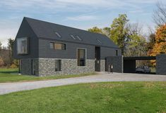 Billis house is a contemporary new build house in rural Co. The design is configured as a long house, a simple confident form, composed of traditional materials; stone, slate, concrete and timber. Contemporary House Plans, Contemporary Architecture, Architecture Design, Architecture Ireland, House Plans Uk, House Designs Ireland, Glass House Design, Ireland Homes, House Ireland