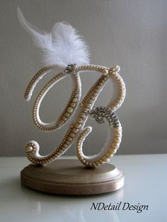 Sooo pretty!  https://www.etsy.com/listing/170011267/cake-topper-monogram-ivory-pearl-white