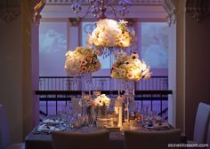 Crystal votives and tall centerpieces of blush tone #roses cascading ...