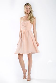"""Brides.com: """"Trending Now: Pretty Peach Bridesmaid Dresses. """"Ella"""" matte silk strapless dress, $298 retail and $125 rental, Lula Kate for Vow to be Chic"""""""