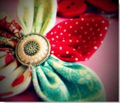 This Vintage Handmade Flower makes the perfect embellishment for any outfit or craft.