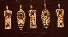 pendants, thinking i could stamp or draw design and then burn over it