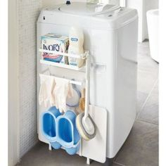 Make laundry day a little less hectic. A one-stop shop for all of your laundry essentials, apply the strong magnetic strips onto the back of this organizer and simply slap it onto the side of your washing machine and dryer. Laundry Storage, Laundry Essentials, Washing Machine, Closet Storage, Stackable Laundry, Machine Storage, Storage, Laundry Basket Organization, Hanger Storage