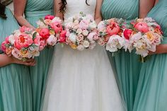 Sea foam green dresses with coral pink flower, I really like those colors together