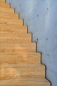 Stairs | Weil am Rhein - Vitra - Conference Pavilion (Tadao Ando, 1993)  Black edging against concrete wall: