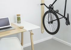 New flat-pack pieces from St Louis-based furniture company Artifox include a vertical bike rack and a standing desk with a writable surface.