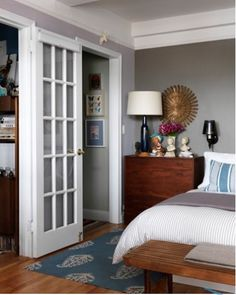 Love gray walls + white french doors on closet