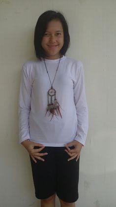 salah satu pemakaian kalung dreamcatcher