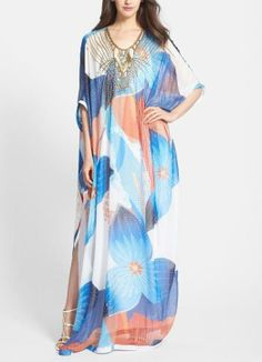 Want this floral print caftan for the next resort trip! The embellished neckline adds glamour and will sparkly in the in the sunshine.