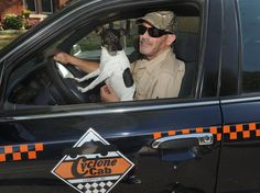 Cyclone Cab driver Mike Seronko poses with Baby Girl, his rat terrier dog, while sitting in his car on Fifth Street Wednesday in Ames. Photo by Nirmanedu Majumdar/Ames Tribune