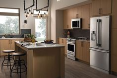 The @frigidaire Professional suite of stainless-steel appliances aims to entice by keeping the total cost of the range, dishwasher, and microwave at about $5,000; add about $3,200 and you can also get the fridge, as shown.
