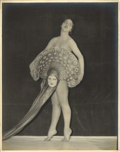 Showgirl Virginia Bell with mask fan c1920