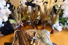 Real tree AP camo material for the ring bearers pillow.  Shotgun shell boutonniere with wheat stock in lieu of flowers.