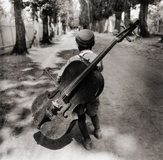 """""""The cello is the most perfect instrument aside from the human voice. --- Gypsy boy with cello, Hungary, Eva Besnyö. Black White Photos, Black And White Photography, Harlem Renaissance, Expositions, Vintage Photographs, Photos Vintage, Hungary, Old Photos, Street Photography"""