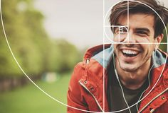 The Fibonacci spiral or golden spiral is used to compose a portrait of a dark haired young man.