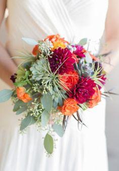 Vibrant dahlia and eucalyptus bridal bouquet.