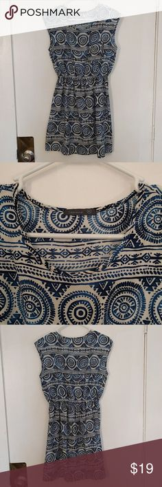 Blue tribal print dress Really cute light fabric. This dress has been worn only a handful of times. Pair with a chunky red or yellow belt and make it pop! Soprano Dresses Mini