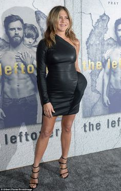The camera loves her! The 48-year-old looked stunning in a skintight leather dress as she left little to the imagination