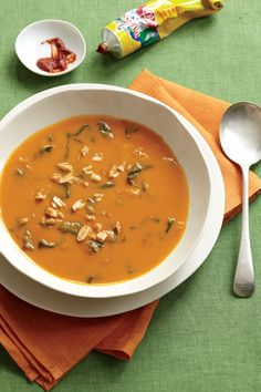 nutty sweet potato soup with harissa and spinach