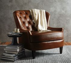 """I wanted a leather chair for reading in my studio, but my sister said it didn't come across as """"studious intellectual"""" chair but more as """"Scotch drinking, cigar-smoking"""" chair. Wingback Accent Chair, Teal Accent Chair, Accent Chairs, Upholstered Chairs, My Living Room, Living Room Chairs, Dining Chairs, Lounge Chairs, Dining Room"""